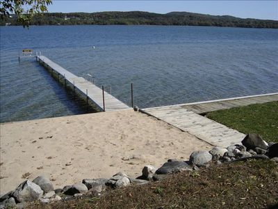Dock with Bench and 2 Ladders, Sand Area, Buoy and Fire Pit.
