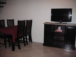 "Playa del Coco condo photo - Dining area for 6 and 43"" LCD TV"