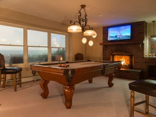 Ithaca house photo - Pool table room with large flat screen television and fireplace