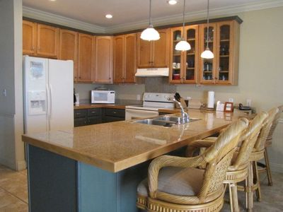 Fully furnished kitchen , granite counters, small appliances, seating for 10