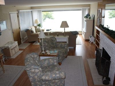 Main floor living area with large picture window with amazing view of the Sound.