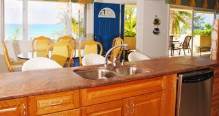 Grand Cayman condo photo - Cook, entertain, yet stay part of the group