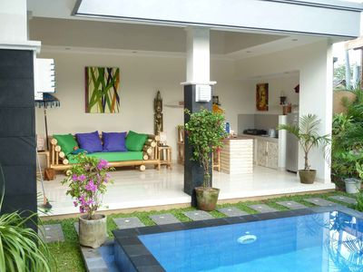 Open plan living area overlooking the garden and pool