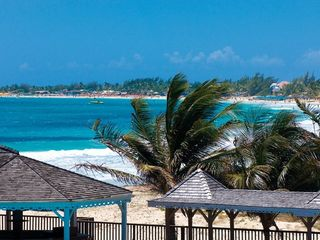 Orient Bay studio photo - View of the beach from the swimming pool