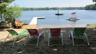 Interlochen cottage photo - Grab a book and relax on the beach