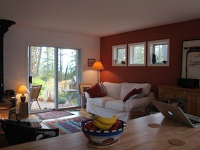Living room. Cozy comfortable room with views across the water to Mount Baker.