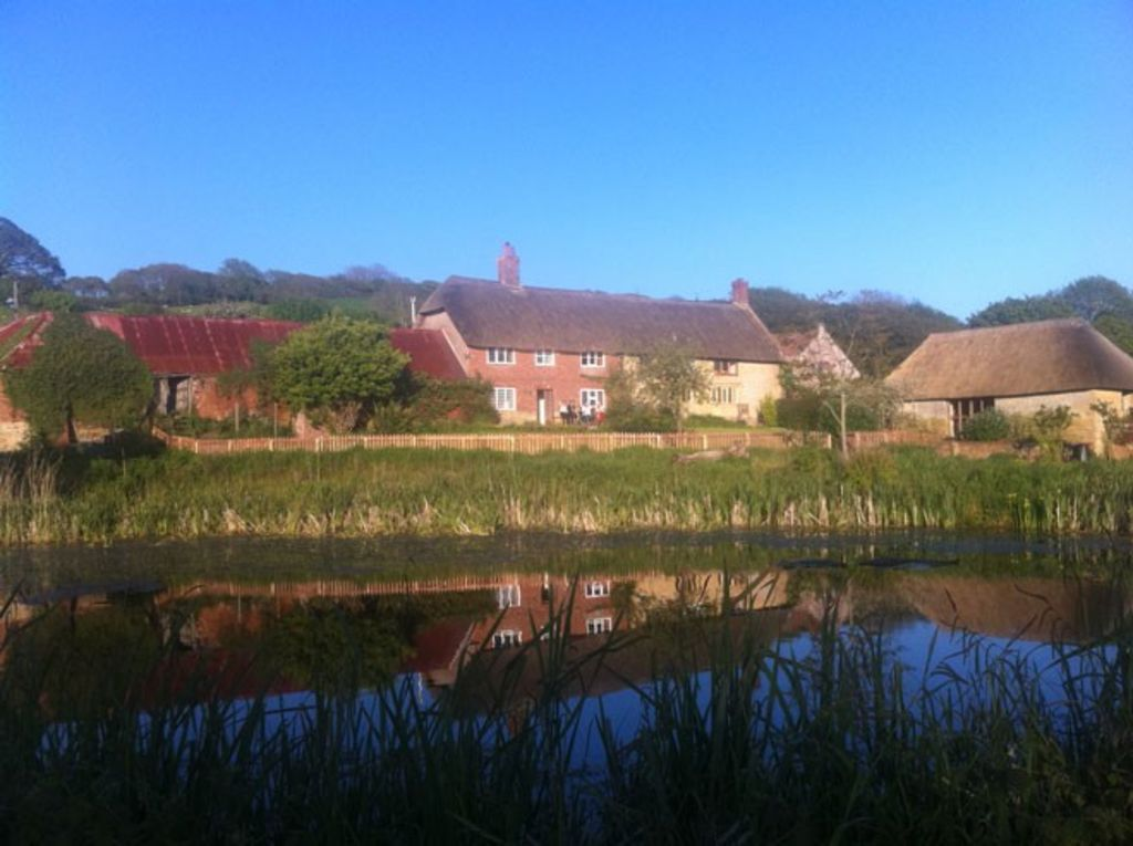 Coastal 6 bedroomed property set in own farmland yet not far from ammenties.