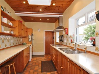 Galley kitchen with all modern kitchen equipment,fride,freezer, double oven.