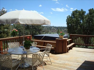 The east deck seating area with hot tub, (large charcoal BBQ not shown on left).