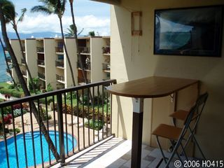 Lahaina condo photo - A Bar-Height Table is attached to the Lanai Wall.