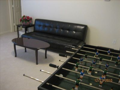 Game room with sofa bad