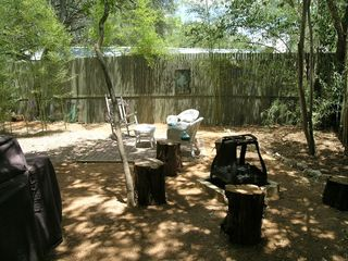 Lakeway cottage photo - Backyard has a picnic table, fire pit, and charcoal barbecue