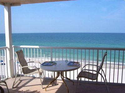 Watch the dolphins and the beach from your balcony.