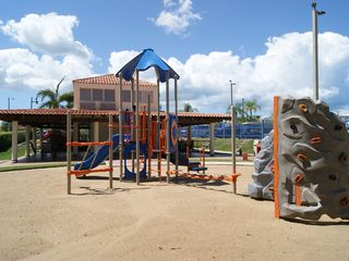 Cabo Rojo apartment photo - Kids playground area. It has BBQ station and water fountain.