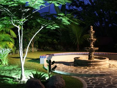 Cascading fountain creates a tranquil ambiance night and day