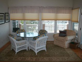 Card table and reading chair in family room - Holgate house vacation rental photo