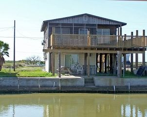 View of home from other side of water canal - Rockport house vacation rental photo