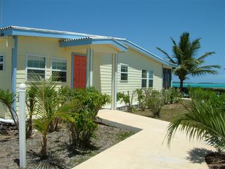 Great Exuma villa photo - Side view showing 2nd entrance to property and lots of windows for extra light!