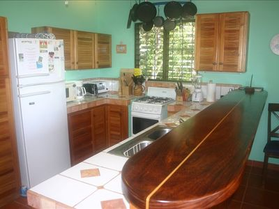 Fully Equipped Kitchen With Longboard Bar