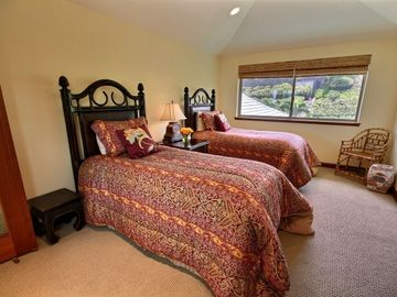Fourth Bedroom with two twin beds and en suite bathroom, on upper level of home.