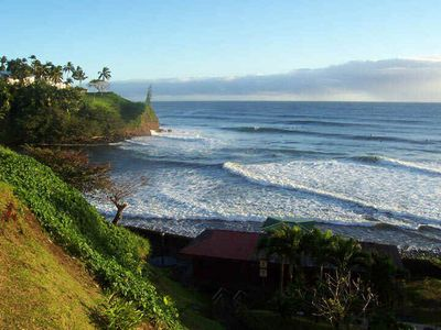 Catch some surf or the sunrise at Honolii by the sea where the locals go.