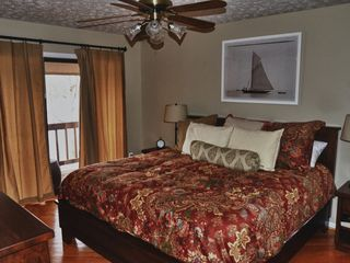 Huddleston house photo - Deluxe, luxurious bedrooms - king bed with balcony lake view