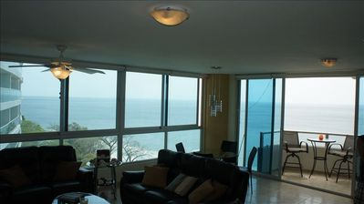 Living area with inside and outside dining ... spectacular ocean & mountain view