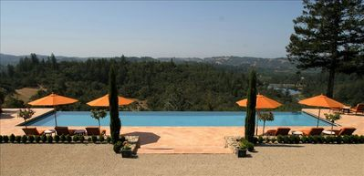 Infinity Pool with views of vineyards, reservoir and hills