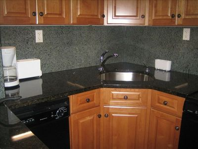 kitchen sink, dishwasher, cabinets