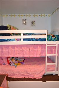 Kids room has a twin bunk with trundle as well as a twin bed also with a trundle