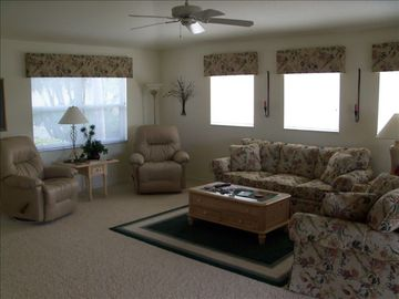 Large living area with his and hers recliners