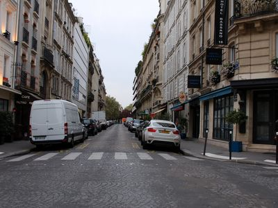 An authentic Parisian street in the middle of Parisian landmarks.
