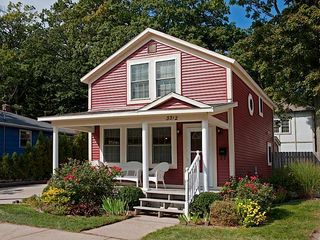 Muskegon house photo - Redbird Cottage w flowering bushes. 3 blocks to Lake Mich, 1 blk to Muskegon Lk