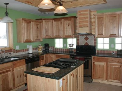 Full Service Kitchen with granite counter tops