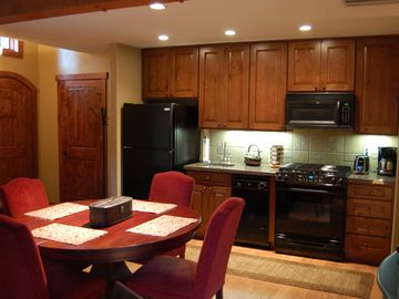 Fully equipped kitchen. Dining table has extension leaf. See other photos.