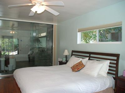 Reverse of master bedroom with king & glass wall leading to master bathroom.