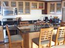 Stainless steel gas gourmet kitchen with great accessories. - Provincetown condo vacation rental photo