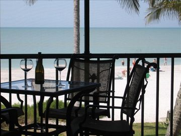 Sanibel Island condo rental - So close, you can see dolphins frolicking in the waves