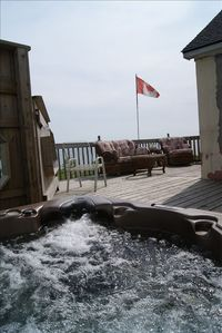 Private hot tub to pulsate you into relaxation while viewing lake