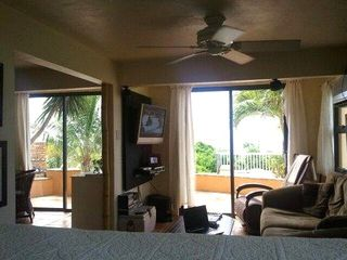Vieques Island house photo - view from the loft to the living space, out to the pool, bar, and ocean view