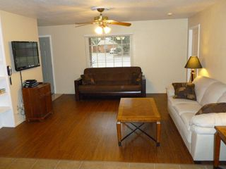 Lubbock house photo - Living area with cable, 42' flatscreen, DVD, and futon that sleeps 2