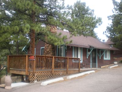 front of Mabel's with shaded deck and views of Longs Peak