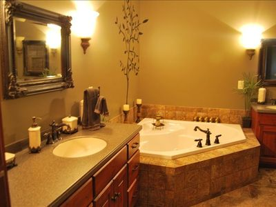 master bath with walk in shower and jacuzzi