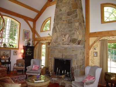 Timberframe greatroom/ Fieldstone fireplace