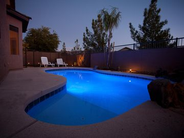 Avondale house rental - Photo showing pool light and yard lighting.