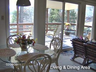 Huddleston property rental photo - Main level dining open to family room