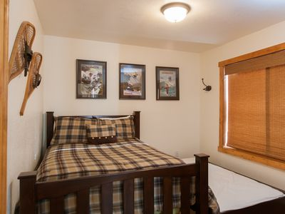 2nd Bedroom: full bed w/ hide-away twin trundle, folding crib and partial views.