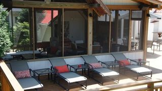 Three Oaks house photo - The 1800 SqFt decks offers all kind of sitting, grab a drink and relax.