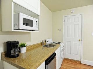Austin apartment photo - Kitchen with dining, pots, pans, plates