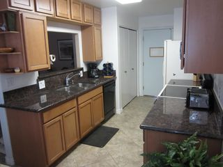Peoria house photo - Updated galley kitchen with W/D area